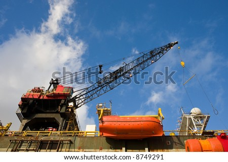external image stock-photo-working-crane-of-an-oil-rig-in-harbor-8749291.jpg