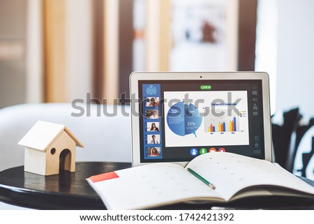 Working Desk with Laptop Computer on Screen Facetime Meeting Presentation Monitor of Multiethnic Business People Having Video Conference Live Streaming - Online Working or Technology Concept