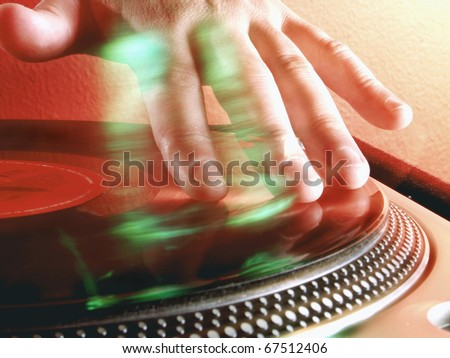 Working Disc jockey at party. Detail of a dj hands.Deejay spinning.