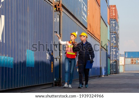 working engineer in the construction container yard.  worker and supervisor checking containers data. Container Shipping Logistics Engineering concept Zdjęcia stock ©