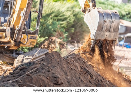 Working Excavator Tractor Digging A Trench At Construction Site.