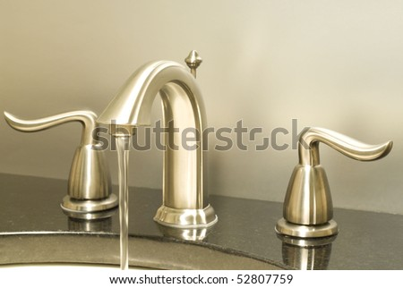 Working faucet - stock photo