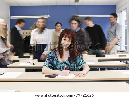 Working girl among moving pupils at the end of the Class