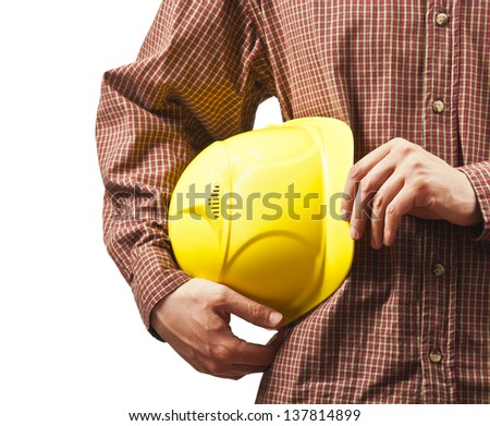 working hands without gloves holding a yellow hard hat close-up isolated on white background