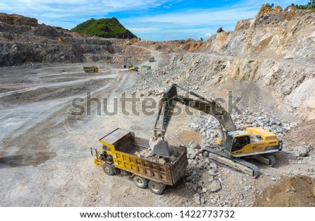 Working hydraulic excavators in the mine. Working in mining industry. Mining activities. Mine operations. Quarry Operations