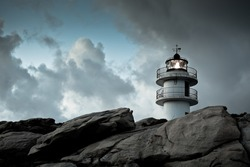 Working Lighthouse at Northern Spain in Bad Weather. Horizontal shot