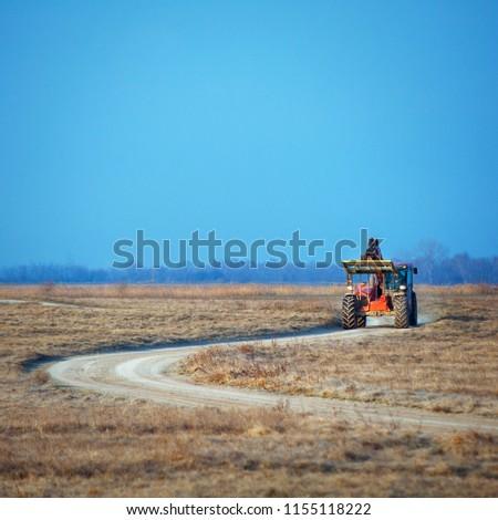 Working machine on a trail #1155118222