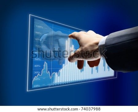 Working man drawing color graphics devoted to business - stock photo