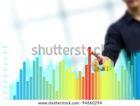 Working man drawing color graphics devoted to business