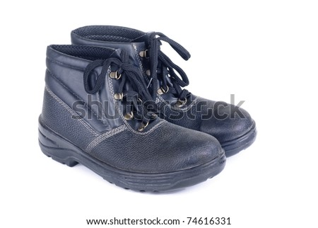 Working man's boots black isolated on a white