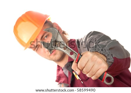 Working man with adjustable wrench. Isolated on white