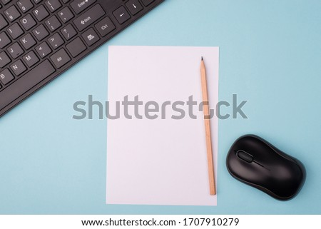 Working near computer concept. Top above close up overhead view photo of sheet of paper computer keyboard and wireless mouth isolated over blue desk background with copy empty blank space 商業照片 ©