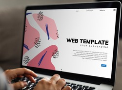 Working on a web template on the laptop