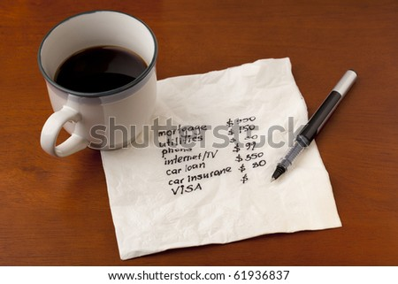 working on household budget - napkin concept with coffee cup on wooden table
