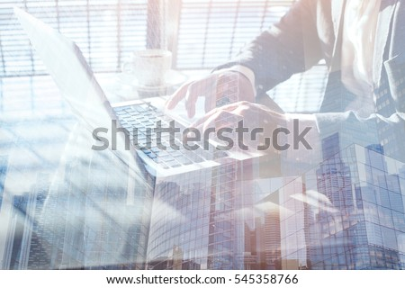 working on laptop computer, double exposure, close up of hands of business man