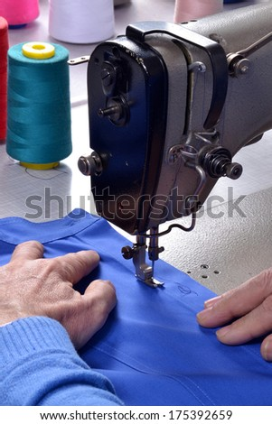 Working on sewing machine.Manufacture industry.Worker on sewing machine. - stock photo
