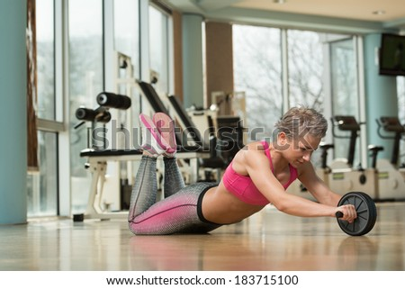 Working Out With Ab Roller - Young Woman Exercising Fitness Workout For Abdominal