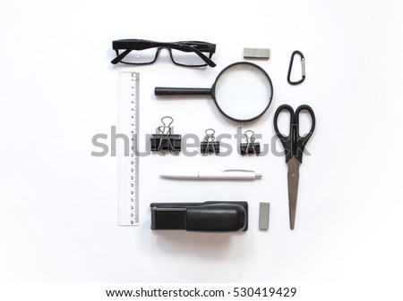 Working place composition with Pen, glasses , magnifier, scissors, line, stapler and other office decoration  on  white background, top view, flat lay
