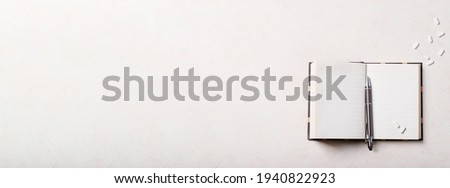 Working place with notepad, pen and antidepressants over white background. Top view, flat lay. Copy space. Concept. Banner