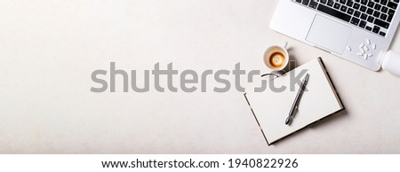 Working place with notepad, pen, laptop, antidepressants and cup of coffee over white background. Top view, flat lay. Copy space. Concept. Banner