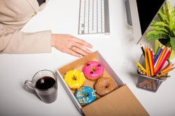 Working space with coffee and donuts