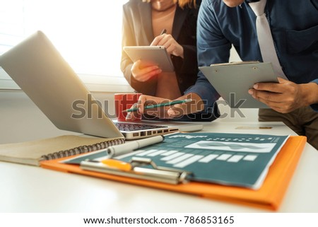 Working team meeting concept,businessman using smart phone and laptop and digital tablet computer in modern office with virtual interface icons network diagram at modern office in morning light #786853165