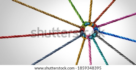 Working team unity and teamwork concept as a business metaphor for joining a partnership as diverse ropes connected together as a corporate symbol for cooperation and worker collaboration.