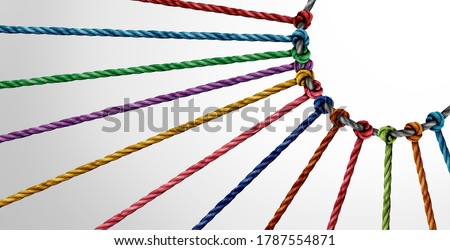 Working together concept and unity or teamwork as a business metaphor for joining a partnership as diverse ropes connected together as a work symbol for cooperation and collaboration.