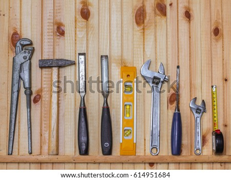 Working tools on wooden rustic background. Top view #614951684
