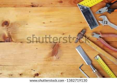 Working tools on wooden rustic background with copy space