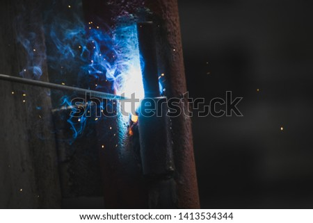 Working with metal and welder #1413534344