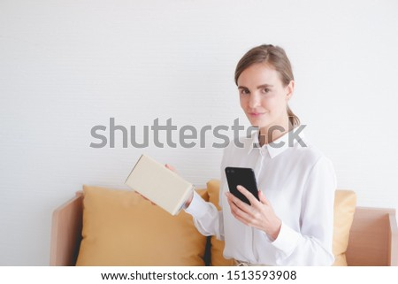 working woman sit on sofa shopping online with smart phone or mobile phone