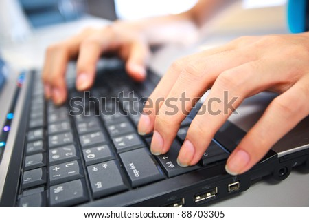 working woman with hands on the key board