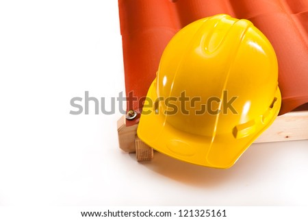 Working yellow hardhat on the edge of the roof on a white background