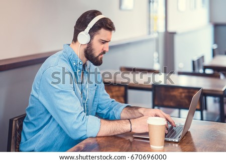 Working young hipster with laptop #670696000