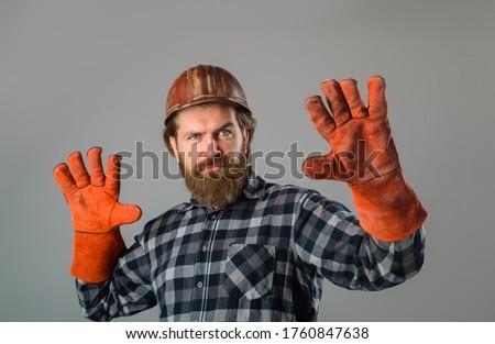 Workman in hardhat. Builder in work gloves. Builder work. Building, industry, technology. Builder in hard hat. Advertise. Repairment concept.