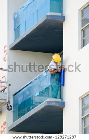 Workman on a balcony