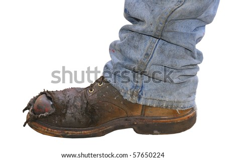 Workman's boot and jeans on a white background