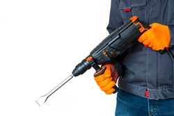 workman with a rotary hammer. isolated Hands in protective gloves with hammer drill perforator. Copy space. isolated