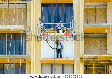 Workmen on suspended scaffolding