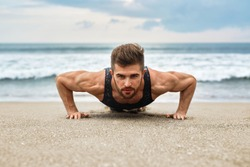 Workout Exercise. Closeup Of Healthy Handsome Active Man With Fit Muscular Body Doing Push Ups Exercises. Sporty Athletic Male Exercising At Beach, Training Outdoor. Sports And Fitness Concept