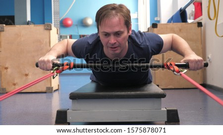 Workout men, warm-up exercises, strength, endurance. training in a fitness club. strengthening muscles of the back. gym workout. Sport lifestyle concept. weight loss in the gym.