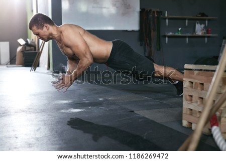 Workout. Sports Man Doing Push Ups With Clap At Sport Club