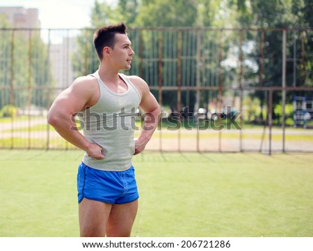 Workout, street sport, training - concept. Handsome man posing outdoors