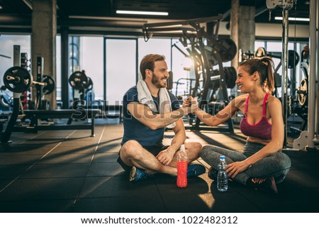Workout with you always is successful. Handshaking. Happy fitness couple.