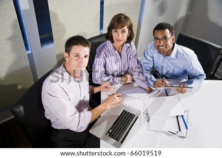 Workplace diversity - multiracial businesspeople working together in boardroom