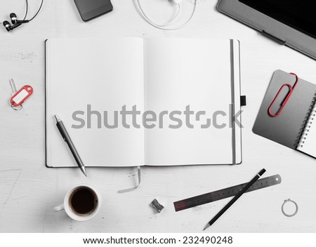 Workplace. Empty notepad, tablet pc and smart phone on white wooden table