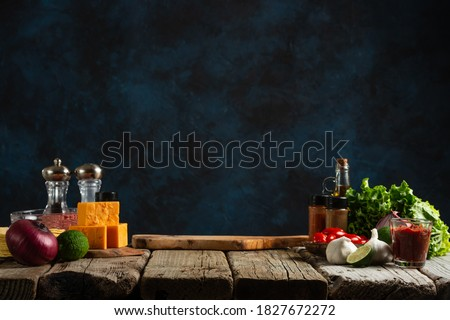 Workplace for cooking meal on dark blue background. Backstage of preparing traditional mexican tacos at the professional restaurant kitchen. Cooking concept. Foto stock ©