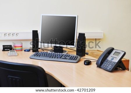 Workplace in office with monitor on work table