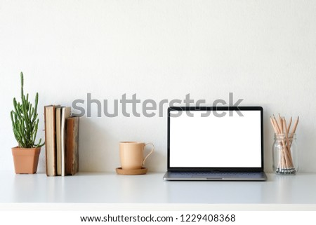 Workplace mockup concept. Mock up home decoration laptop and office supply with copy space for products display montage. #1229408368